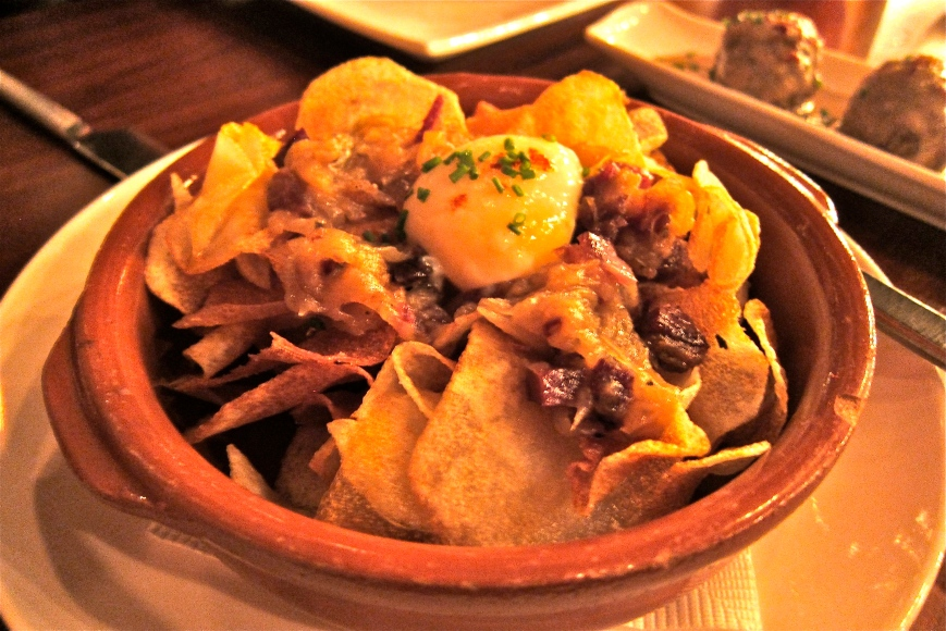 Organic Egg Slow Cooked at 63° served with Ibérico Ham on Onion Confit anf Fried Potato