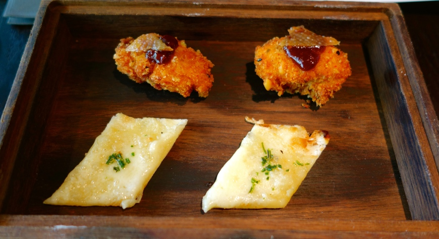 Amuse bouches of garlic, cheddar and rosemary flatbread, with fried chicken topped with a lovely (tomato?) jam