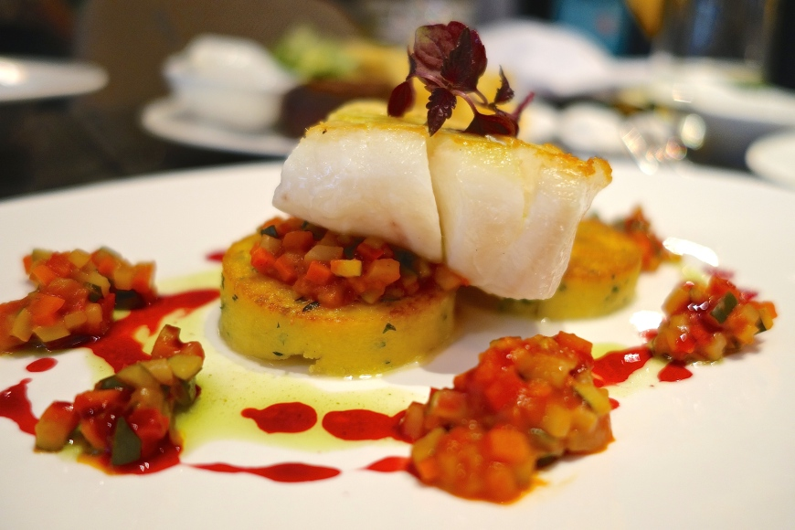 Codfish Mediterranean Style - spiced ginger polenta, ratatouille, red beet reduction