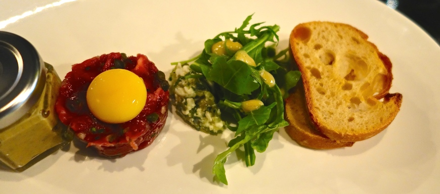 Steak Tartare -  truffle egg yolk, salad